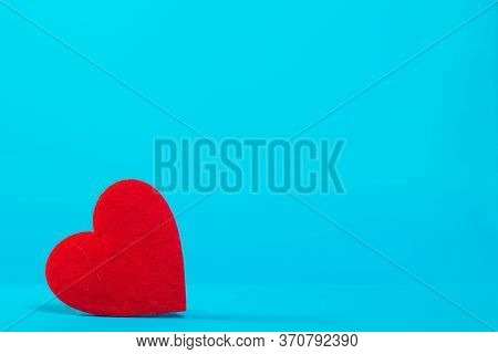 Bright Red Heart On A Blue Background In The Left Corner