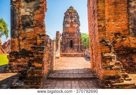Pagoda At Ayutthaya Historical Park On A Sunny Day In Ayutthaya Province, Thailand. Architecture Of