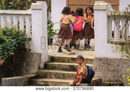 Probolinggo, Indonesia - June 14, 2013: Happy Children Smiling And Playing After School In A Village