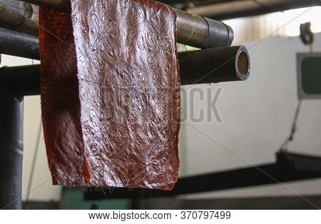 Batik Textile With Wax Hanging In Winotosastro Factory In Yogyakarta, Java, Indonesia. Batik Motif S