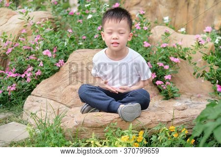 Cute Healthy Happy Smiling Little Asian Toddler Boy Child With Eyes Closed Practices Yoga & Meditati