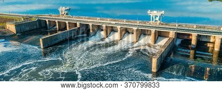 Aerial Panoramic View Of Hydroelectric Dam On River.