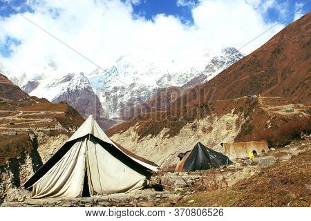 Camping and the beautiful himalaya.A tent in the trek of kedarnatha temple, uttarakhand, india. this is in the lower Himalayan range.
