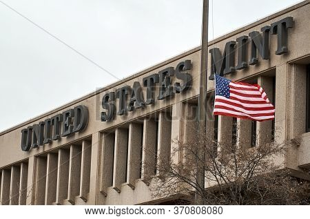 United States Mint Building And Flag. The United States Mint Is A Bureau Of The Department Of The Tr