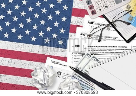 Irs Form 990 Return Of Organization Exempt From Income Tax Lies On Flat Lay Office Table And Ready T
