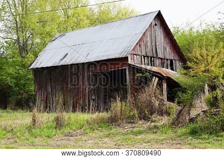 Old Abandoned Barn With A Tin Roof
