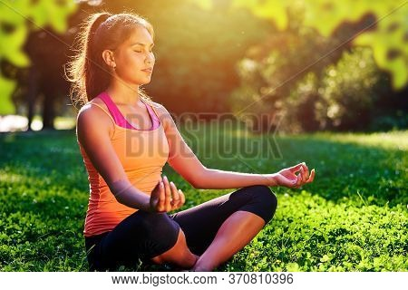 Yoga. Mixed Race Woman Practicing Yoga Or Dancing Or Stretching In Nature At Park. Health Lifestyle