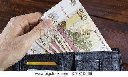 The Lot With Russian Rubles Is Pulled Out By Hand From The Wallet With Credit Cards.paper Banknotes
