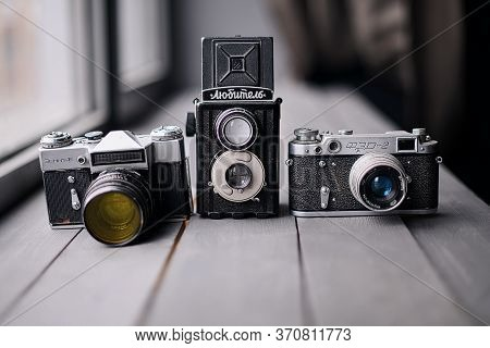 Three Old Reflex Cameras Isolated On Wooden Background Vintage Twin Lens Reflex Camera