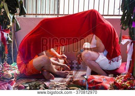 Kathmandu,nepal - June 11,2019: Hindu Holy Boy Learning Religious Gayatri Mantra From His Grandfathe