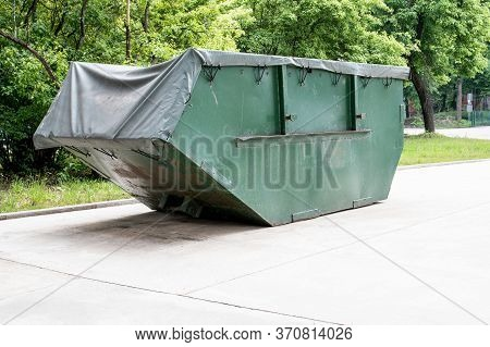 Waste And Rubbish Container With Cover. Transportation, Recycling And Care For A Clean Environment
