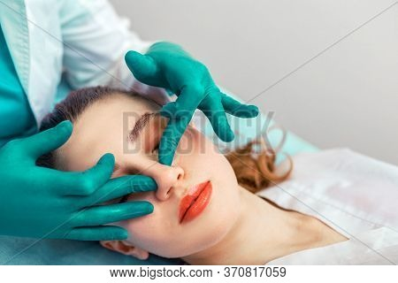 Rhinoplasty, The Surgeon Hands Touches The Patient S Nose. Plastic Surgery And Beauty Concept - Surg