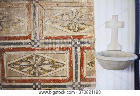 Hornachos, Spain - May 31st 2020: Fresco Painting Remains Beside Holy Water Font. Franciscan Convent