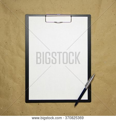A Tablet With A White Sheet Of A4 Format With Pen On A Beige Craft Paper. Concept Of Analysis, Study