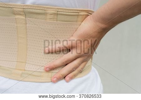 Close Up Orthopedic Lumbar Corset On The Human Body, Back Support For Muscle Back.