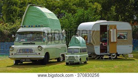 Upper Dean, Bedfordshire, England - September 07, 2019:  Classic Bedford Camper Van With Caravan - T