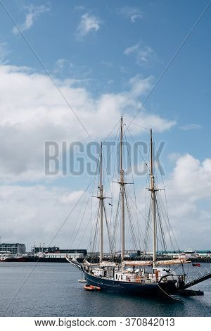 Sailing Wooden Ship With Three Masts Moored In The Port Of Reykjavik, In The Capital Of Iceland.