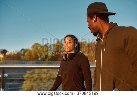 Young African Female Athlet Talking With Her Boyfriend Before Morning Jog. African Sporty Couple Run