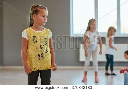 Portrait Of A Little Cute Girl Looking Away While Having A Choreography Class. Group Of Children Sta