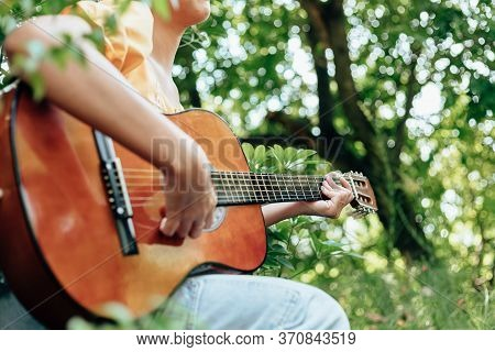 Woman's Hands Playing Acoustic Guitar Have Fun Outdoor, Close Up.