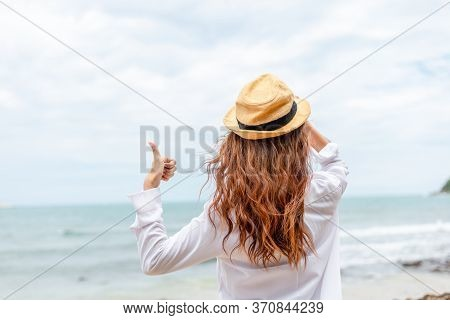 Smiling Young Woman In Sun Hat And Finger Thumb Up On Beach. Summer, Holidays, Vacation, Travel Conc