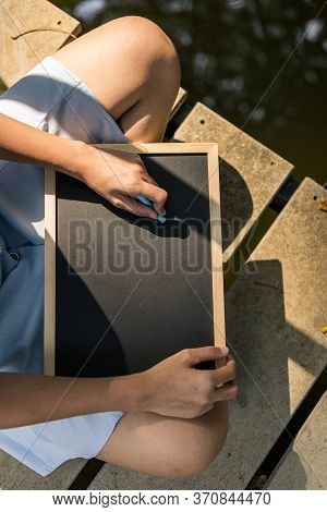 Hands Use Chalk For Drawing, Writing Balckboard In The Parks. Education, Learning Concept.