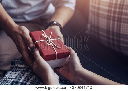 Christmas, Valentine, Holidays Gift Box Concept. Couple Surprise Gift Box Together.
