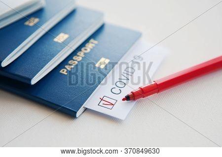 Immunity Passport, Risk-free Certificate Concept. Note Covid-19 Coronavirus, Passport, Red Pen And C