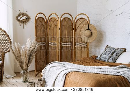 Comfort Bedroom In Boho Style Interior With Pillow And Bedspread On Bed, Bamboo Dressing Screen, Hom