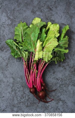 Group Of Chard With Beetroots. Young Beetroot With Fresh Leaves On Dark Background