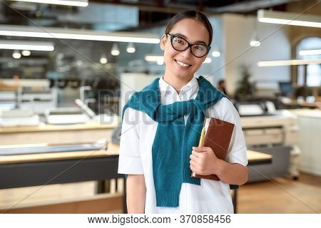 Portrait Of Attractive Ambitious Asian Businesswoman In Casual Wear And Glasses Holding Notebook, Wh