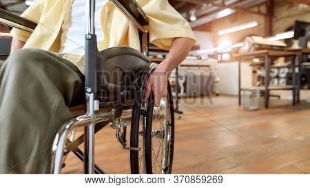 Cropped Portrait Of Young Male Office Worker In A Wheelchair Moving Around In Co-working Space. Disa