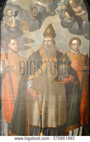 ZAGREB, CROATIA - MAY 16, 2013: Saint Denis holding his head, altar of Saint Dionysius in the Church of Saint Catherine of Alexandria in Zagreb, Croatia