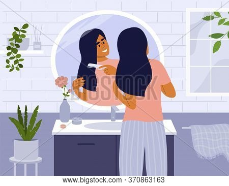 Daily Morning Routine. Cute Girl Standing In Front Of Bathroom Mirror Combing Hair. Woman Making Hai
