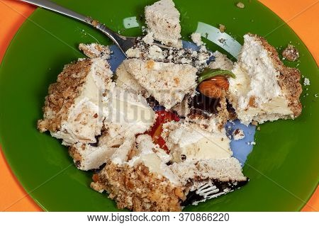 Close Up Pieces Of Cream Cake Crashed In The Green Plate With Fork. Anti Diet Concept, Unhealthy Des