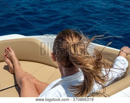 Woman relaxing on a yacht in the summer time