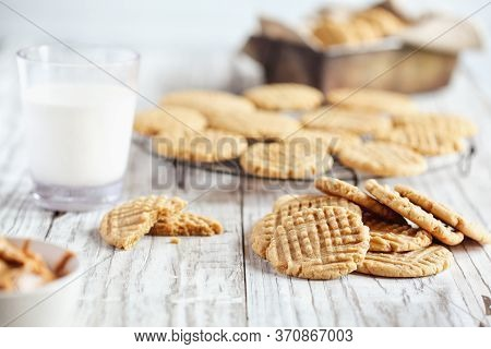 Fresh Baked, Homemade Peanut Butter Cookies And Milk Over A White Rustic Table. Selective Focus With