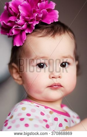 Adorable Sweet Baby Girl With Big Pink Flower On Head, Closeup Portrait Of Cute Girl, Beautiful Todd