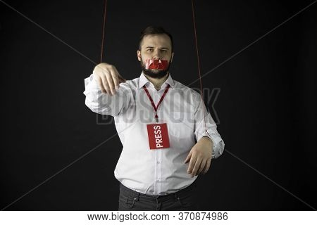 Dependent Man With Badge Press Holds Hands Tied With Ropes Like Marionette With Wrapping Mouth By Ad
