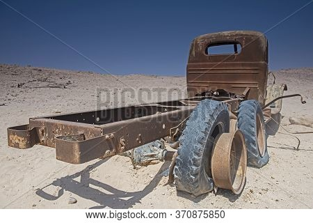 Remains Of A Rusty Old Abandoned Derelict Truck Left In The Desert To Decay