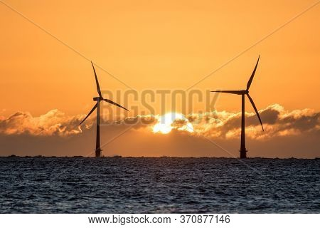 Solar Energy And Wind Power. Sustainable Resources. Beautiful Sky Sunrise Behind Silouette Of Wind T