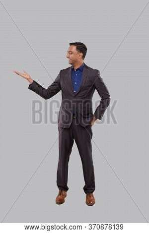 Businessman Showing To Side Isolated. Indian Man Standing Full Lenght