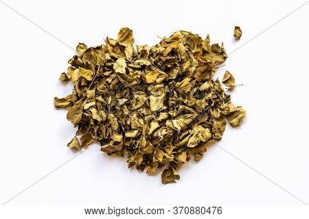 Dried Medicinal Leaves Moringa On A White Background, Horseradish Cooked In A Dehydrator
