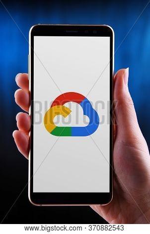 Poznan, Pol - May 21, 2020: Hand Holding Smartphone Displaying Logo Of Google Cloud Platform (gcp),