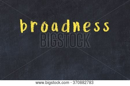Chalk Handwritten Inscription Broadness On Black Desk