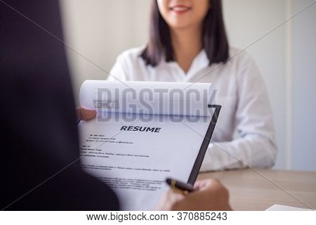Business People Reading Resume Documents Of Job Applicants. Job Interviews From A Wide Range Of Resp