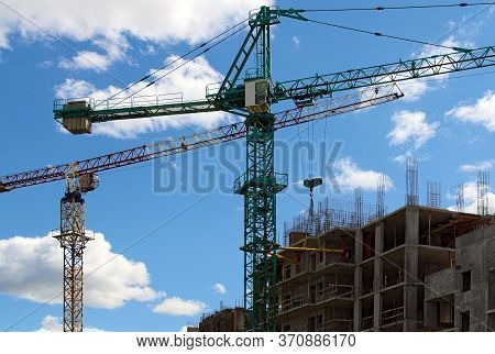 Close-up View Of The Process Of Installation Tower Crane. Installation Work. Tower Crane Is Fixing W
