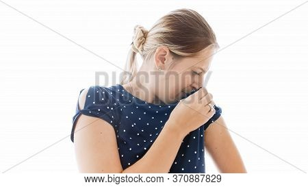 Isolated Portrait Of Young Woman Smelling Her Sweaty Stinky Armpits