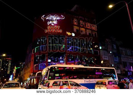 Ho Chi Minh City, Vietnam - March 27,2019: Neon Lights Of Restaurants And Bars On Bui Vien Walking S