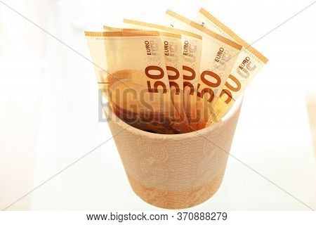 Paper Money Grows In A Flower Pot On A Windowsill. The Economic Growth. Salary Growth. The Growth Of